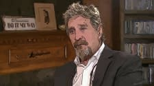 """McAfee Promosikan Cryptocurrency di """"Hotel Prodeo"""" Spanyol"""